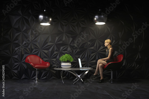 young woman in dark living room interior