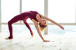Quadro Peaceful good-looking woman using her body flexibility for extreme stretching