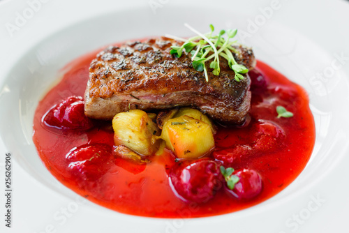 Steak  from fillet of a duck with caramelized strawberry and an eggplant - 256262906