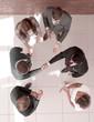 Leinwanddruck Bild - top view.business partners shaking hands