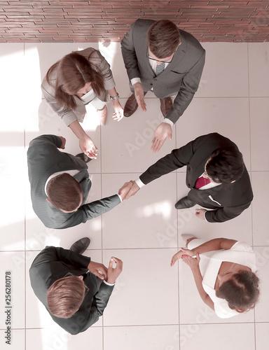 Leinwanddruck Bild top view.business partners shaking hands