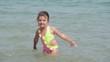 Funny kid splashing water.