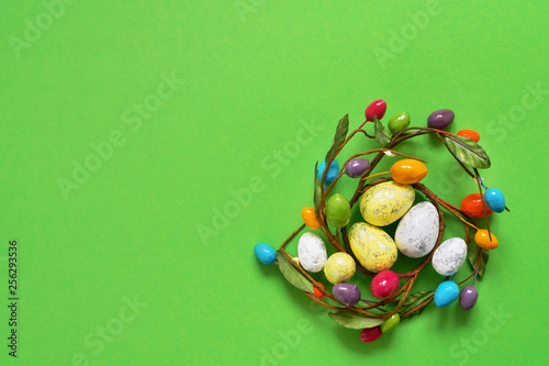 Easter decoration on green background. Copy space, top view. - 256293536