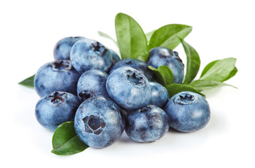 heap of fresh blueberry with leaves isolated on white background