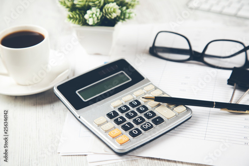 calculator with coffee and keyboard on desk
