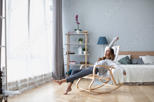 Full-length body gorgeous good-looking attractive pretty lady with her beaming smile she stretch oneself indoor cosy modern room. © BestForYou