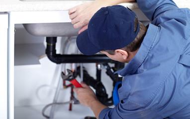 plumber repairs a sink. © Kurhan