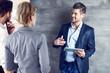Leinwandbild Motiv Business people talking at office using tablet