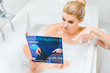 Leinwanddruck Bild - selective focus of attractive and blonde woman taking bath with foam and pointing with finger at beauty and style magazine