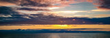 Panorama of midnight sun and clouds in the Norwegian Sea