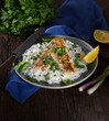 grilled fish fillet with rice on a wooden background. Rustic style. - 256502985