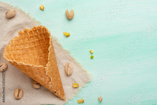 Cones with ice cream and pistachios on a light background