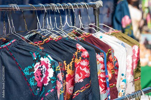 national Ukrainian clothes are sold at the fair, hanging on a hanger