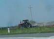 Leinwanddruck Bild - Traktor beim Pfflügen