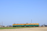 The train running on the rural area in Toyama Japan.