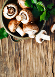 Fresh mushrooms on wooden background, top view
