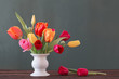 Leinwanddruck Bild - beautiful tulips in vase on green background