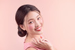 Beautiful asian girl with professional makeup and stylish hairstyle  isolated on pink. Cosmetics and make-up