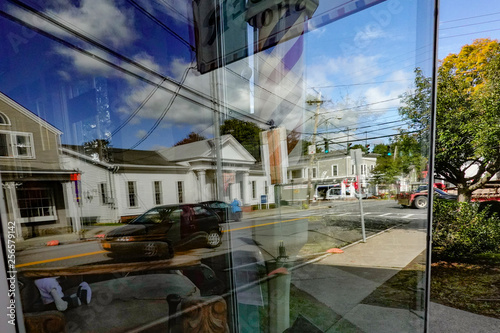obraz PCV Pine Plains, New York USA Main Street USA and reflection from barbershop window.
