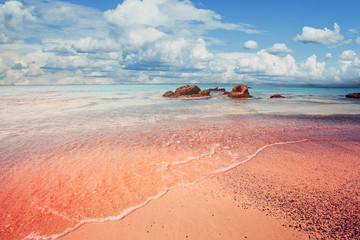 Beautiful Elafonissi beach on Crete, Greece. Pink sand, blue sea water and clouds sky