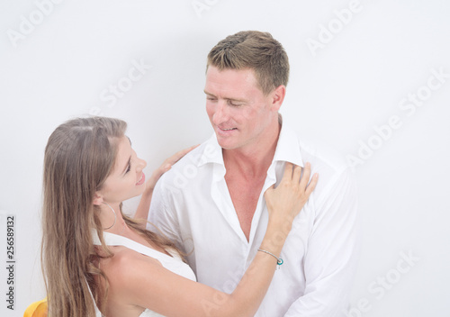 portrait of nice young couple on white  background