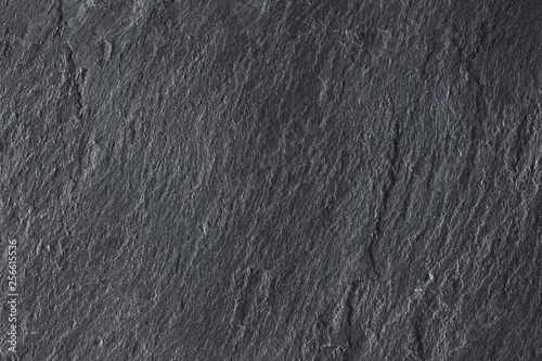 dark grey slate background texture with copy space for your text © Andrea