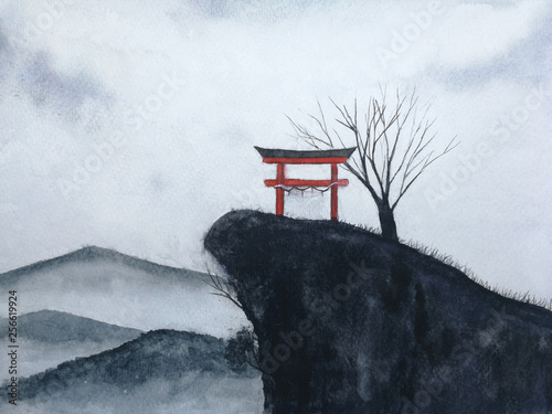 watercolor landscape  japanese gate on the mountain and dead tree cover fog. traditional oriental ink asia art hand drawn style. © atichat