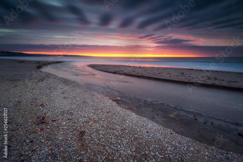 On the seashore at sunrise / Amazing sunrise view with colorful sky at the Black Sea coast