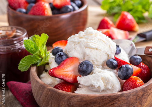 Bowl of Vanilla Ice Cream With Blueberries and Strawberries