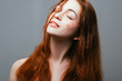 Quadro Peace of mind. Freedom of youth. Young redhead female. Eyes closed. Naked shoulders.
