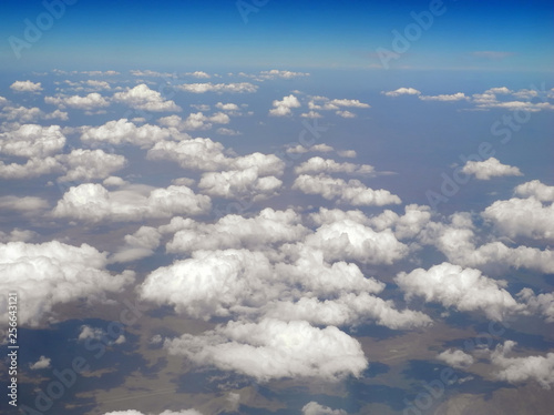 Aerial landscape of small clouds over mountainous terrain - 256643121