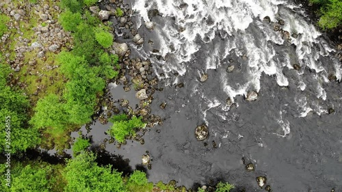 Top down view of fast moving river, Norway nature in summertime