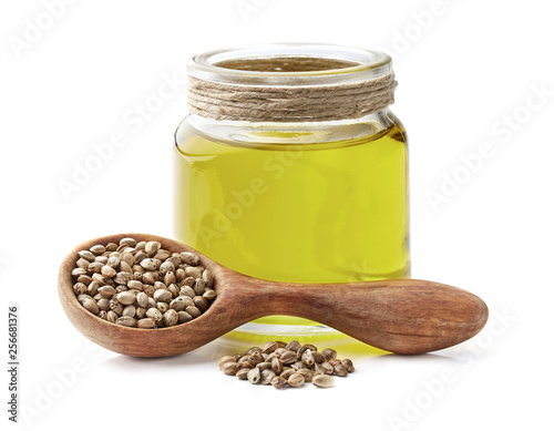 Hemp oil with seeds in closeup