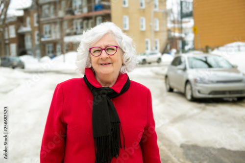 A Close up Happy senior adult Woman on winter season at the City Street