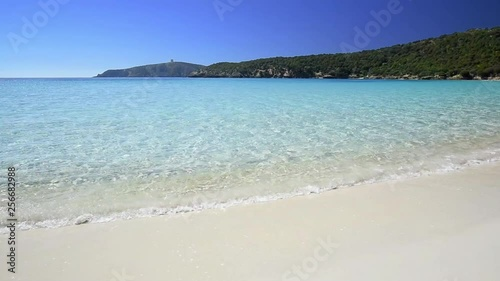 Desert beach on the south of Sardinia, turquoise sea and white sand on a clear beautiful day.