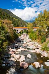 stone bridge over river Isarco, Chiusa, Italy © Corinne
