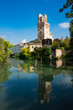 tower of Astronomical Observatory of Padua, Italy, along the river., with reflection