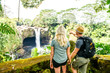A couple at The Rainbow Falls, Hilo, Wailuku River State Park, Big Island, Hawaii - 256733128