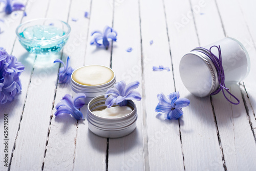skin care product samples and purple hyacinth flowers on white wooden © tstock