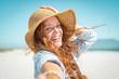 Leinwanddruck Bild - Smiling mature woman with straw hat