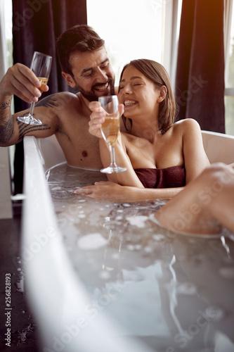 Leinwanddruck Bild Romantic moments in the bathroom - Couple Relaxing In Bubble bath.