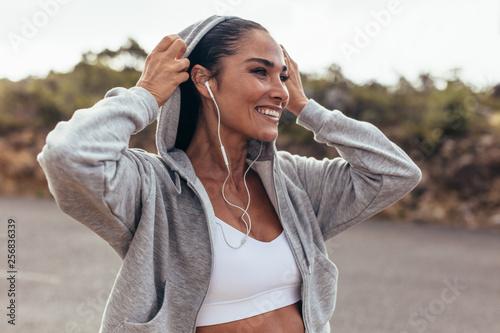 Fototapeten Fitness Smiling female on morning walk