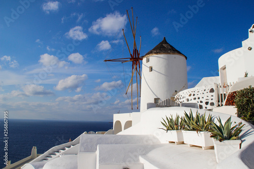 The medieval small windmill is the main attraction of the romantic island of Santorini. Greece.