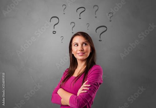 Leinwandbild Motiv Person with question marks around face