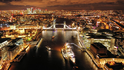 Aerial drone high resolution night photo of iconic Tower Bridge in the heart of City of London, United Kingdom