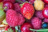 Fresh ripe berries background: raspberries, strawberries, cherry