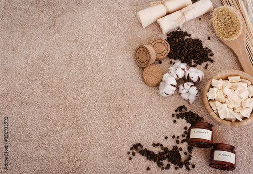 canvas print picture Top view spa and wellness setting with natural bath salt, soap, candles, towels, cotton flowers and coffee beans for massage for perfect healthy body and skin. Beauty luxury spa concept. Copyspace
