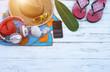Leinwandbild Motiv Beach Accessories On Table On Beach - Summer Holidays