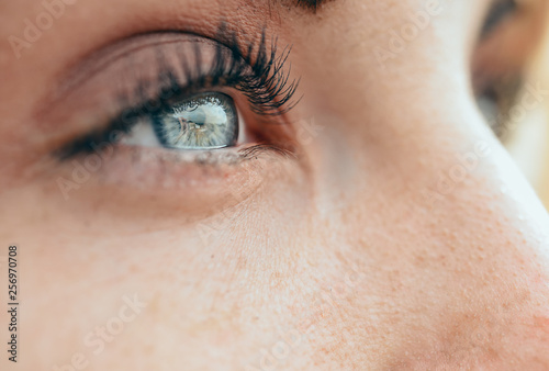 Make-up beautiful young woman's blue eyes © javiindy