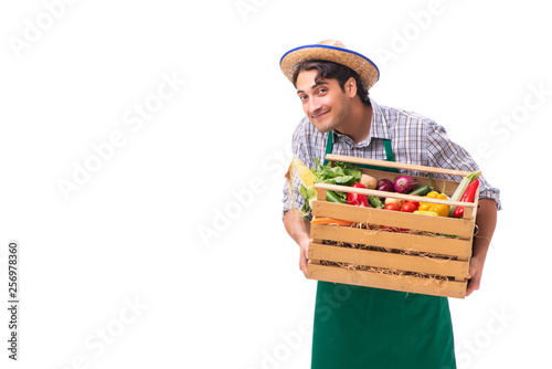 Leinwandbild Motiv Young farmer with fresh produce isolated on white background